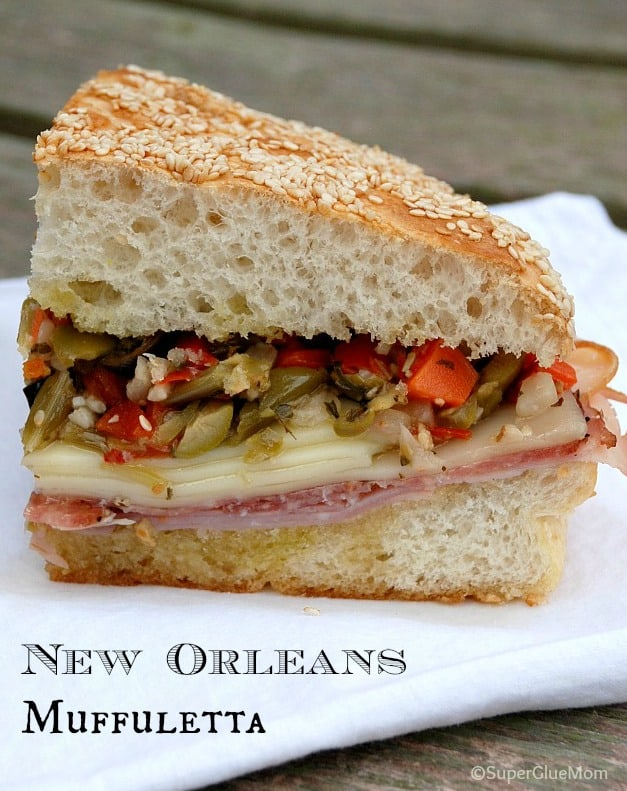 image: Quarter of a Muffuletta Sandwich  Image text reads: New Orleans Muffuletta