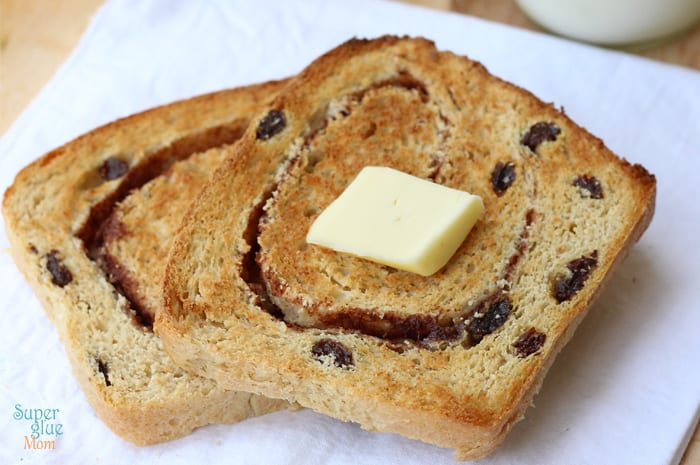 Check out how easy it is to make your own cinnamon raisin bread with a lot less sugar than the store bought ones! Bonus: this recipe yields 3 loaves and freezes well!
