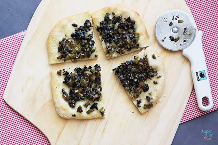 Black and Green Olive Tapenade Pizza Slices via SuperGlueMom.com