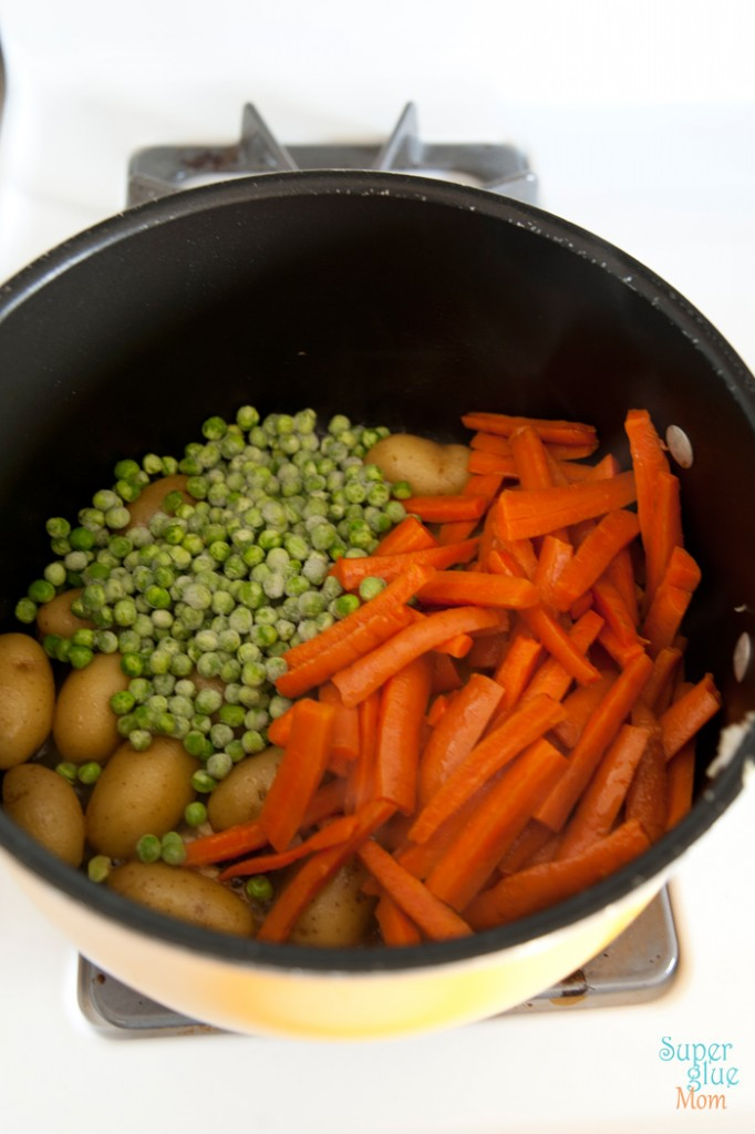 Carrot, fingerling potato, and pea ragout recipe is perfect for the holidays or any meal gathering via SuperGlueMOM.com