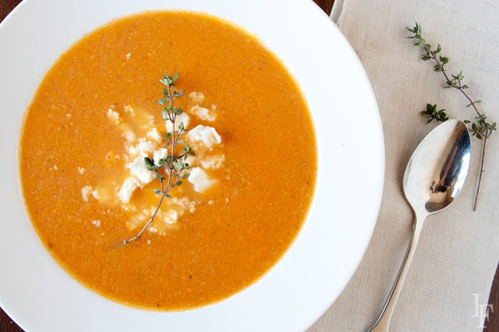 Image: Tomato soup in a white bowl with spoon to one side