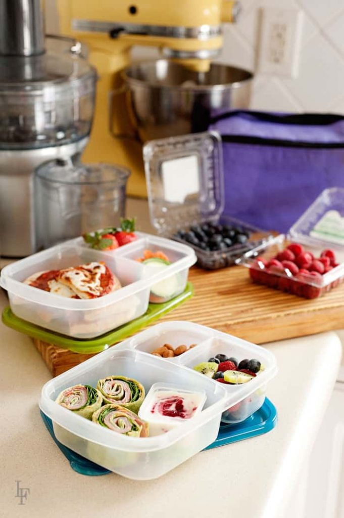 stream line your lunch packing routine by placing all your ingredients on the counter and then filling the lunchboxes