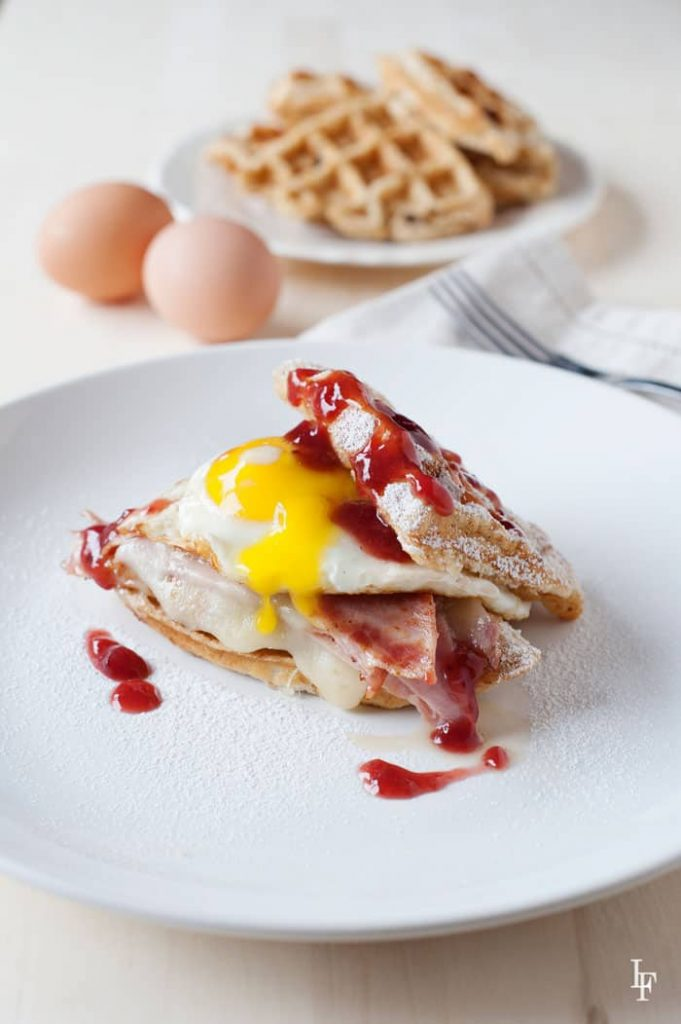 Food Network's Rewrapped Waffle Monte Cristo Sandwich - holy egg! you've got to try one! egg, ham, cheese, and waffles - wow!