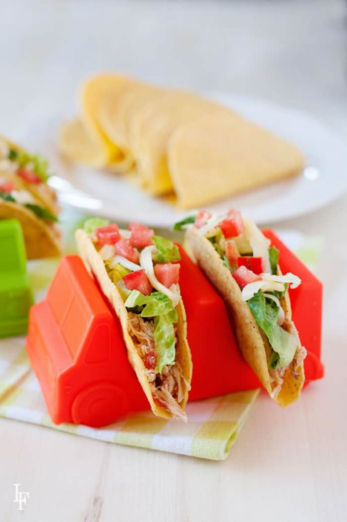 "Easy Crockpot Chicken Tacos your kids will love. The perfect ""set it and forget it"" recipe. Taco trucks: http://bit.ly/kidtacotrucks"