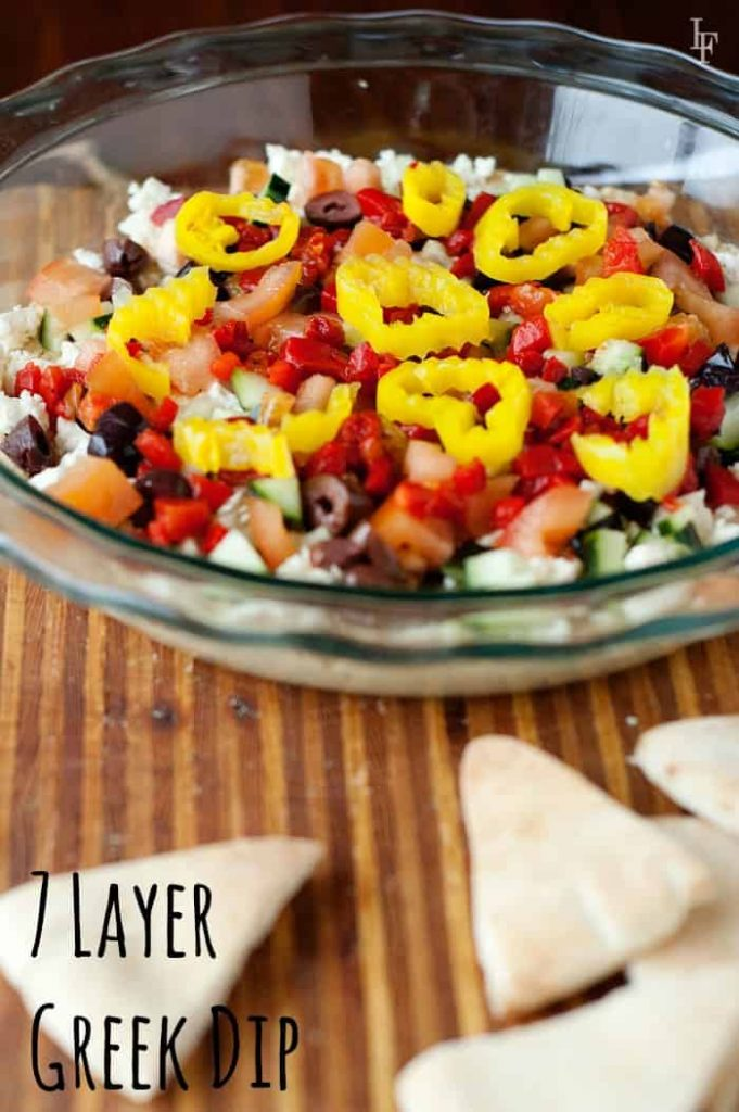 an easy 7 layer dip recipe is perfect for game day as an appetizer and for easy entertaining!