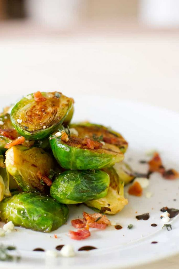 caramelized Brussels sprouts on a plate with baon