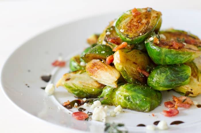One pan easy caramelized brussels sprouts with bacon recipe. a delicious side dish in minutes!