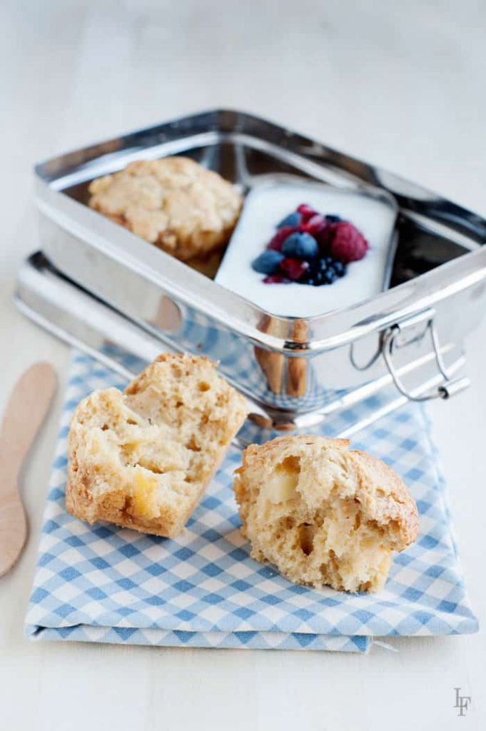 baked apple fritter muffin for breakfast inside a lunchbox with plain yogurt