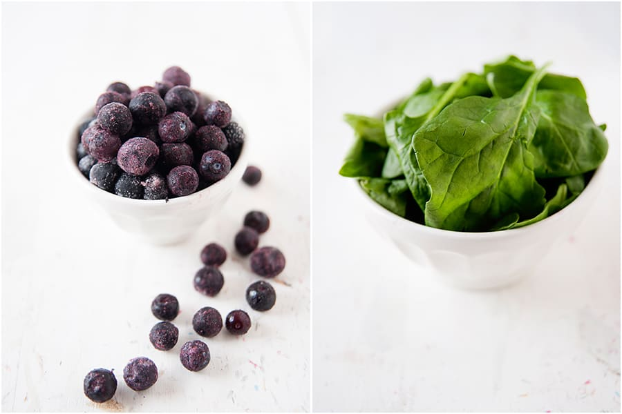 two side by side images. One white bowl of frozen blueberries. One white bowl of spinach leaves