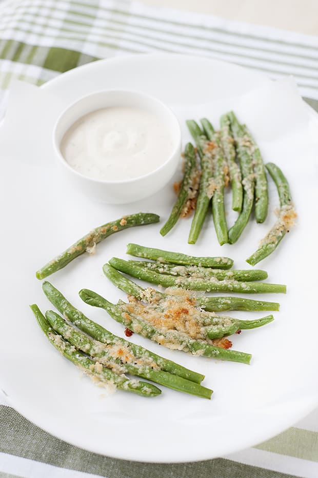 Crispy, cheesy green bean fries are the perfect food for picky eaters to try more green veggies.