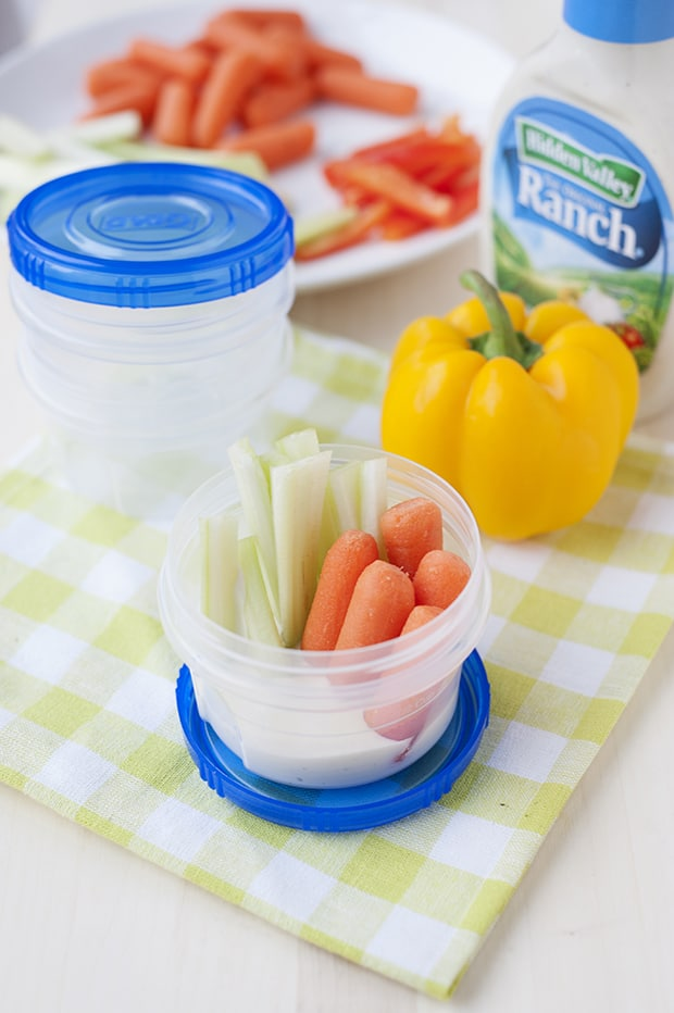 fresh veggies and a little ranch in portable cups make this an easy snack idea!