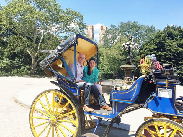 laura and eric on a carriage ride through central park
