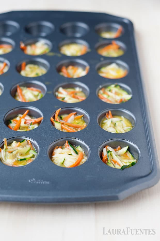 image: uncooked mini quiches in muffin pan