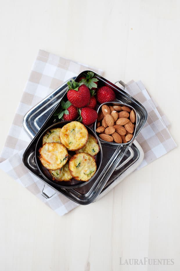 Image: Silver lunchbox with mini quiches, strawberriess and whole almonds