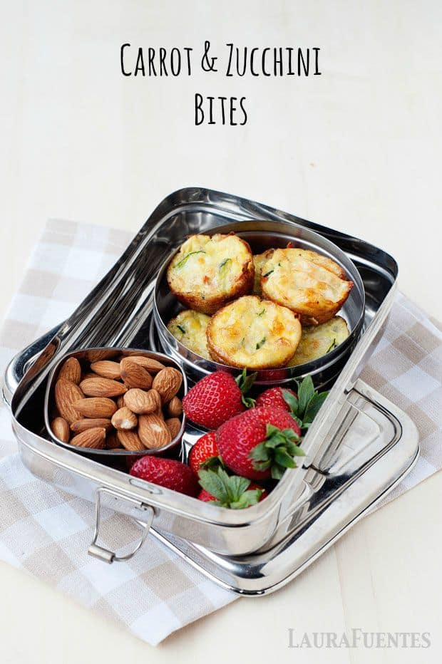 Image: silver lunchbox with bowl of almonds, strawberries and small egg cups
