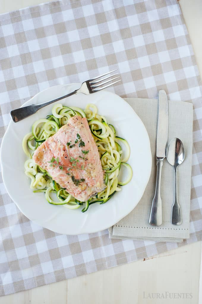 Salmon baked in foil is always perfectly juicy, flaky, and never dry! Here it's served over spiralized zucchini sauteed in a little olive oil and garlic