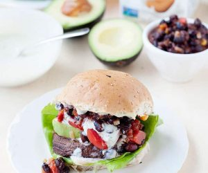 These meatless Monday portobello mushroom burgers are incredible with the Southwestern Avocado Ranch drizzled on top!