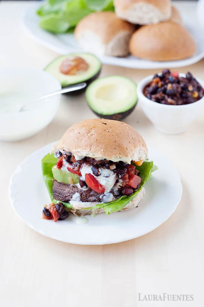 These meatless Monday portobello mushroom burgers are incredible with a vegan Southwestern Avocado Ranch drizzled on top!