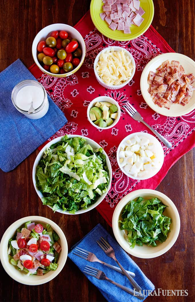 get picky eaters to learn how to love salads by making a salad bar with fresh ingredients