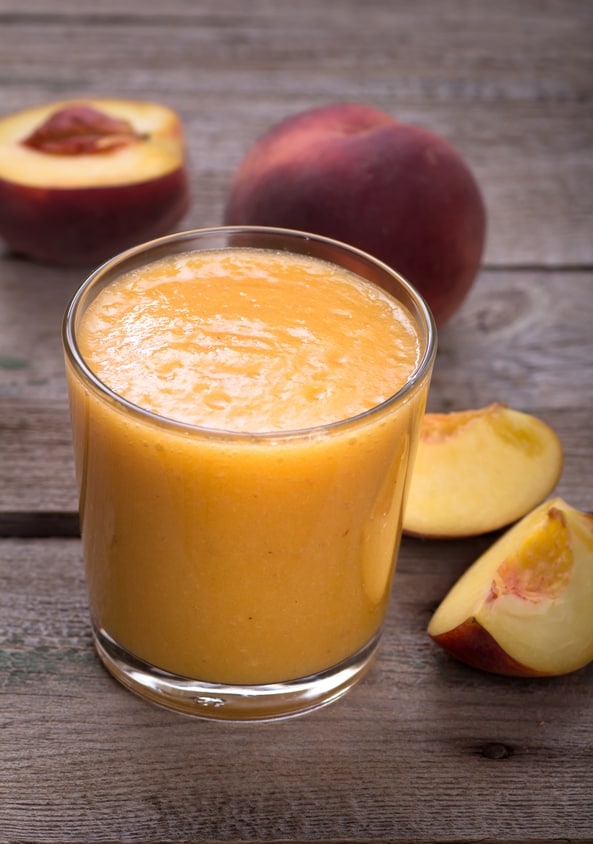 image: small glass cup of peach mango smoothie