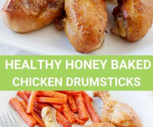Image: baked chicken drumsticks and carrot fries on a white plate