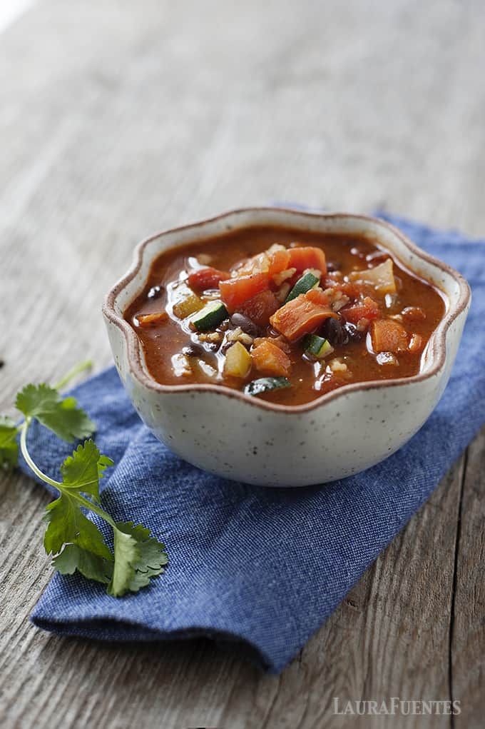 This hearty Mexican bean and vegetable soup recipe is one you'll be making often. It freezes great and it has a slow cooker option!