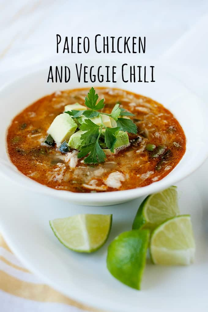 image: bowl of chicken chili with  chopped avocado and cilantro on top image text reads: Paleo Chicken and Veggie Chili