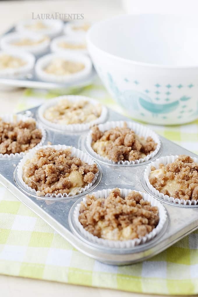 Image: pear crumble muffins on a blue plate.