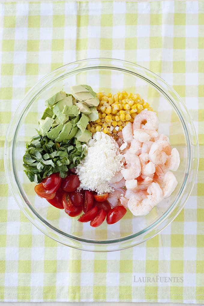 This corn, tomato, avocado, and shrimp salad recipe is easy to make and comes together in one bowl!