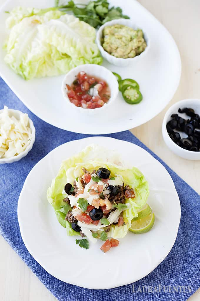 Have dinner ready in 15 minutes with these Taco Stuffed Lettuce Cups! Full of classic taco flavor, this is a gluten and grain free meal everyone will love.