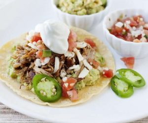 Slow Cooker Pork Carnitas: An easy and delicious meal that your slow cooker cooks for you! Plus, it's tacos!