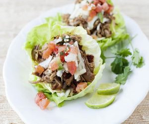 Slow Cooker Pork Carnitas Lettuce Cups: One of my favorite things to eat this summer has been lettuce cups! I have been making all of my favorites into a cooler options for these hot summer days. Check out this easy recipe!