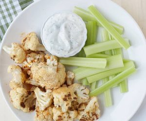 Healthy Buffalo Cauliflower Bites: Perfect for an appetizer, snack or side dish when you want to add a little heat and keep it healthy. Paleo, gluten-free and grain-free.