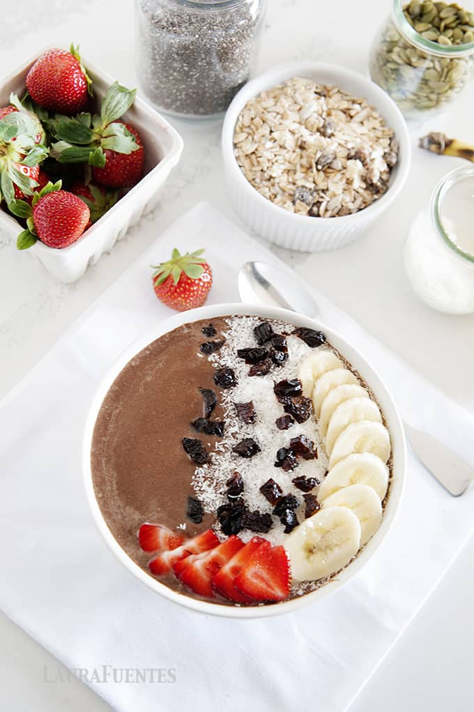 chocolate smoothie bowl topped with fruit