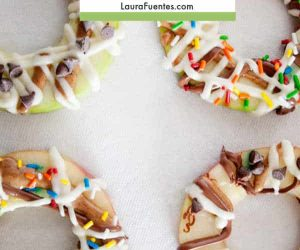 apple donuts with sprinkles and icing on top
