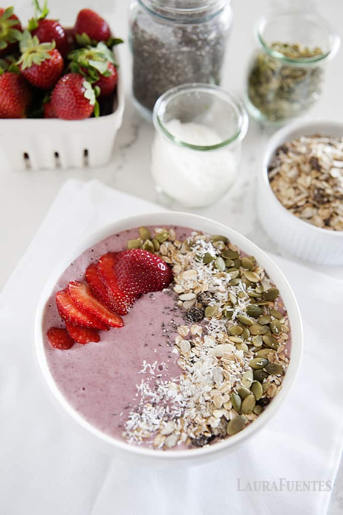 Strawberries and Cream Lower Sugar Smoothie Bowl: Few things are better than a rich, thick, creamy smoothie after a workout that tastes like strawberries and cream. This is a lower sugar, healthier option!