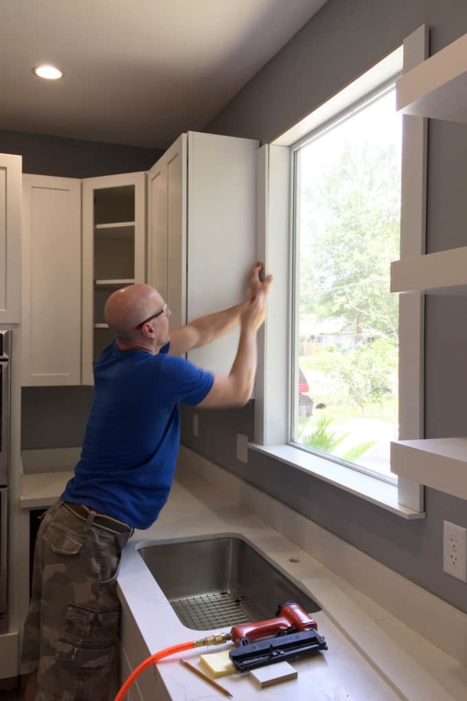 Need to give your plain, unframed window a new look? With $10 and an afternoon of fun, you can give any window a makeover with a farmhouse window trim.