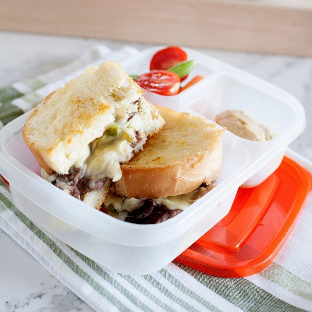 philly cheesesteak grilled cheese in a lunch container
