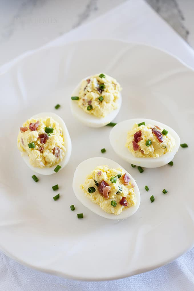 You are not going to believe how good these deviled eggs taste. They taste just like a loaded baked potato but without any of the carbs! Bacon, Eggs and Cheese? YES!