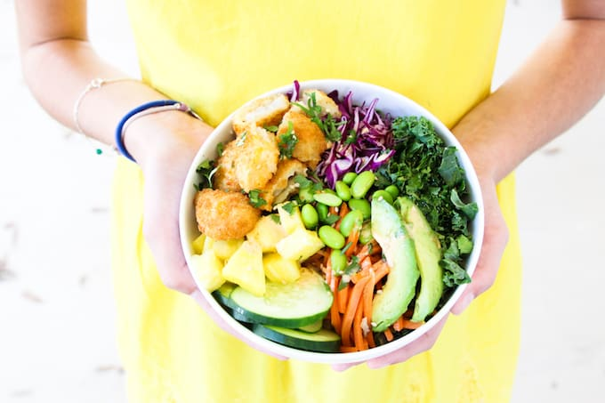 Easy to make for a quick, healthy midweek meal, these homemade Crunchy Fish Poké Bowls that even the pickiest of eaters will love!