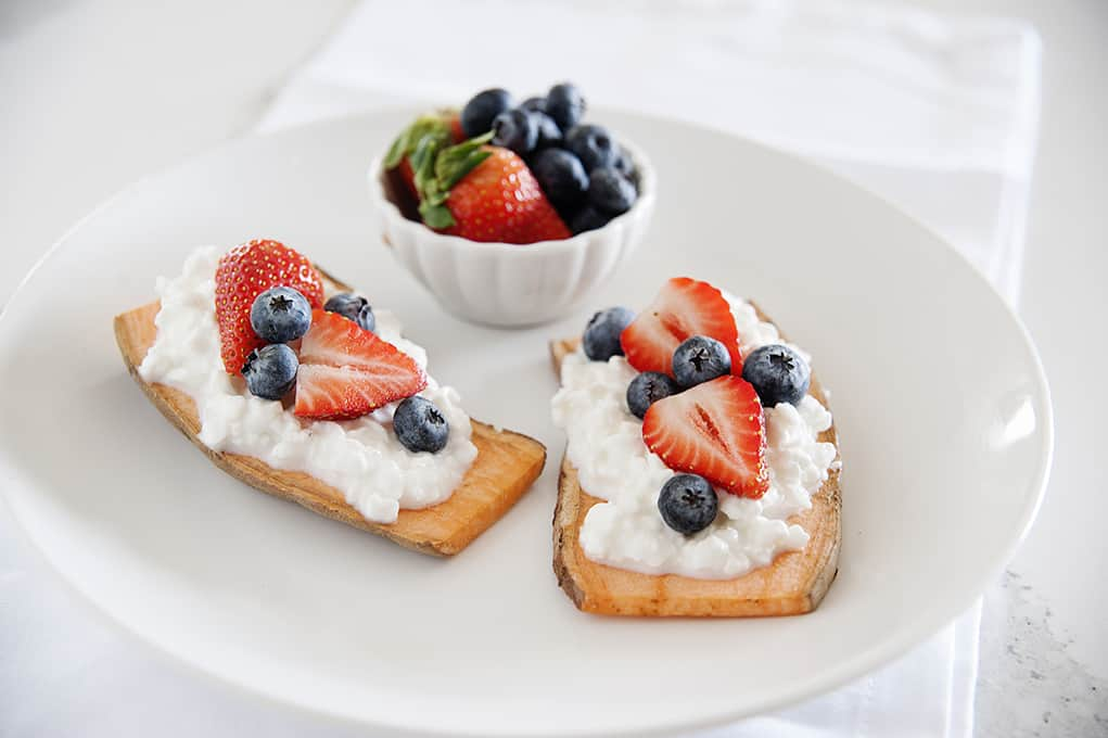 Add a little protein to your sweet potato toast with today's delicious idea. Topped with berries, it's one healthy breakfast or snack!