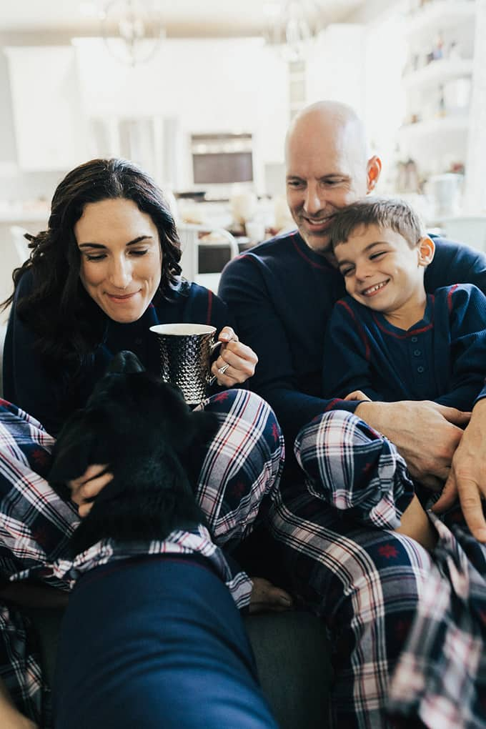 Laura Fuentes with family in matching pjs christmas morning