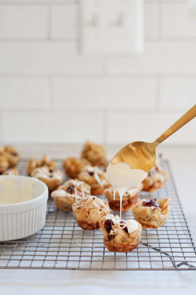 cranberry orange bread pudding bites with a white chocolate glaze