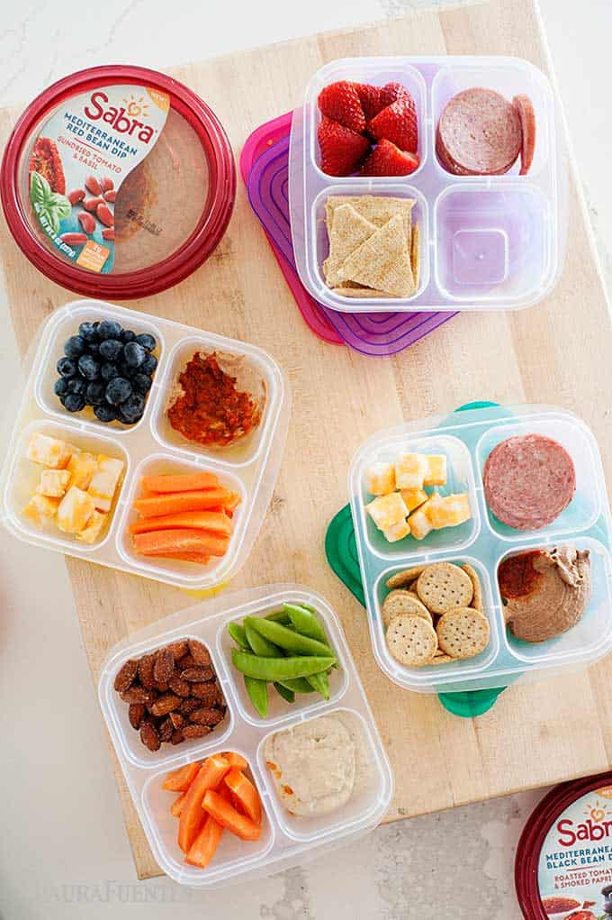 antipasto snack boxes with fruits, veggies, and hummus