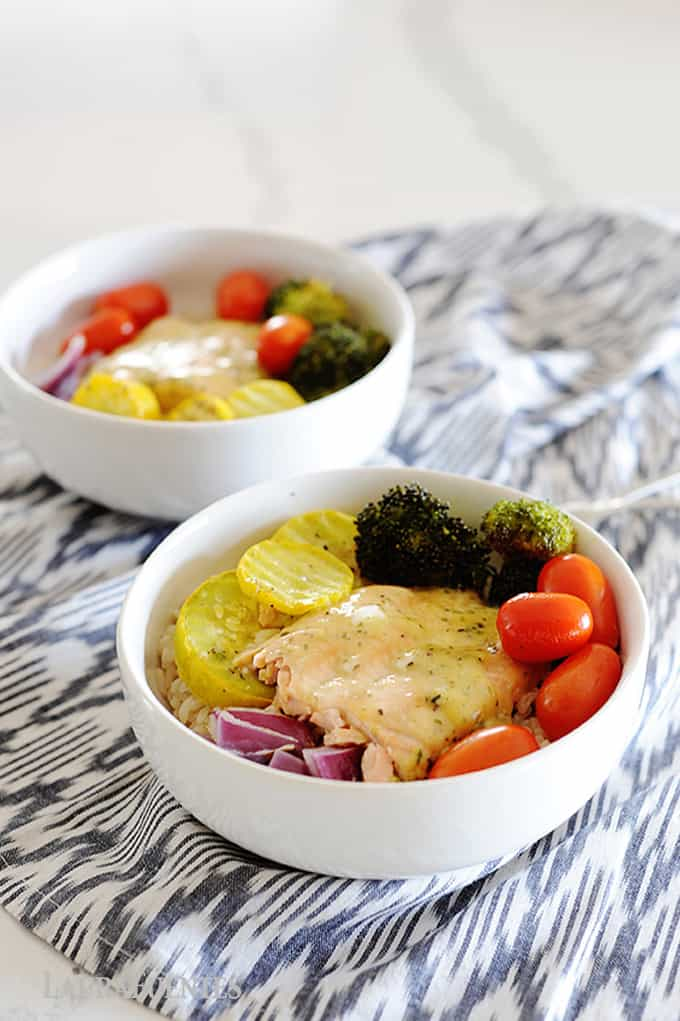 Easy sheet pan garlic butter salmon bowls with roasted veggies over rice