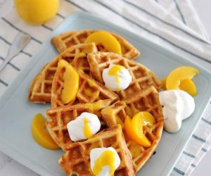 peaches and cream waffles with homemade peach syrup