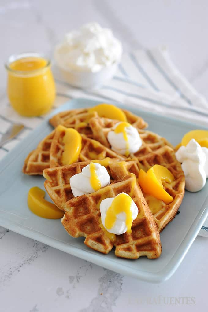 peaches and cream homemade waffles with peach syrup