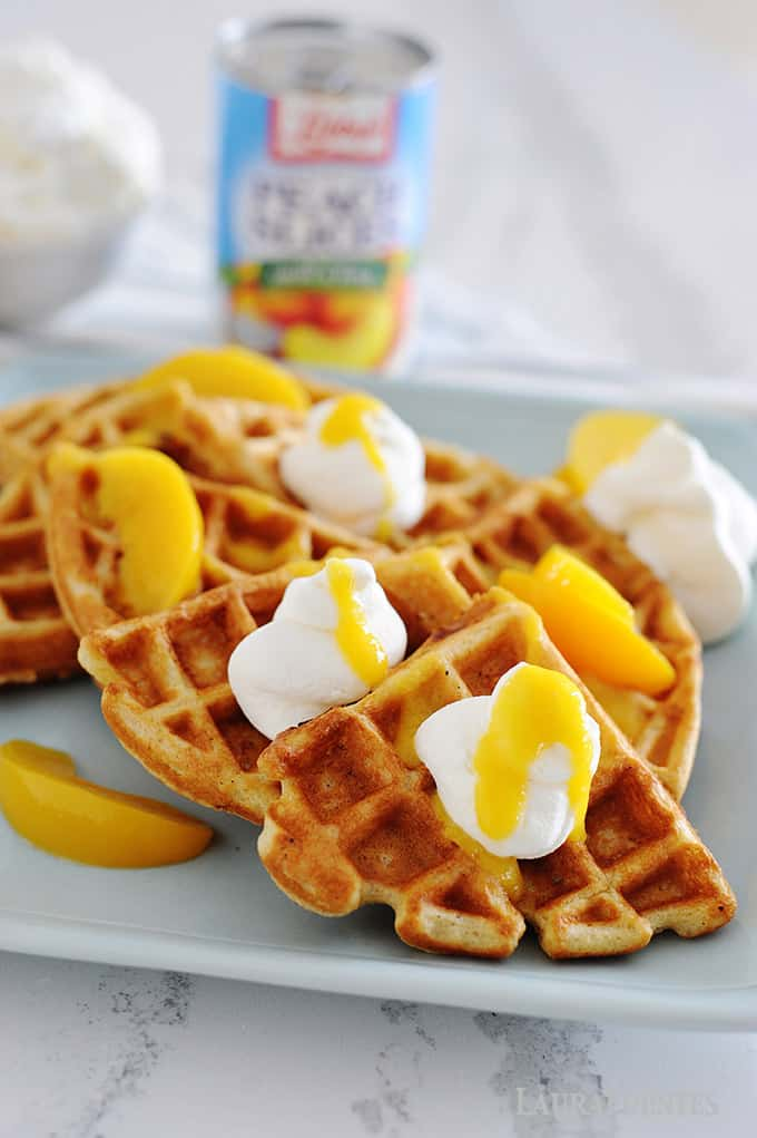 peaches and cream waffles with homemade peach syrup and whipped cream