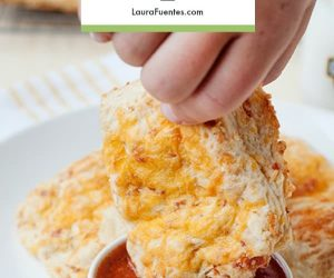These Pizza Biscuits are warm, flaky, buttery goodness with all the flavors of pizza! It doesn't matter if you serve them for breakfast, lunch or dinner they are sure to be a hit. These pepperoni and cheese stuffed biscuits are an awesome breakfast for dinner recipe!