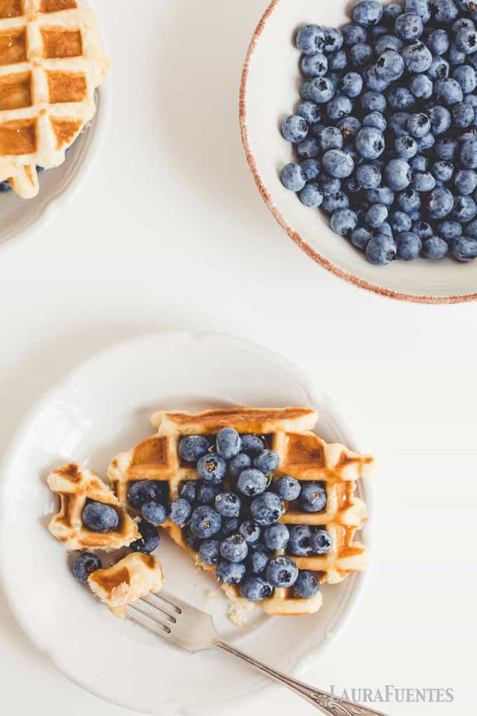 These classic buttermilk waffles are the perfect recipe to make and freeze! They are perfectly crispy on the outside topped with fresh blueberries - they are a breeze to make!